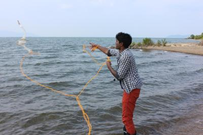 Throwing a plankton net at Lake Biwa