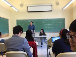 "In the class room of ""Business Speaking"", making presentation to other students"